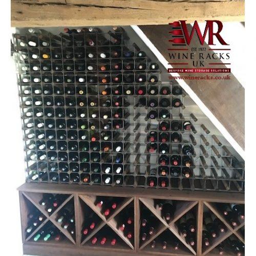 Pine cubes and galvanised steel wine racks under stairs