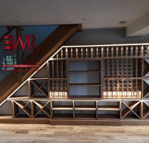 Solid oak medium oak stain wine racks under stairs